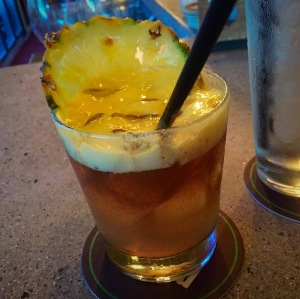Monkeypod Mai Tai with old lahaina light rum, maui dark rum, lime, mac-nut orgeat, orange curacao, honey-lilkoi foam